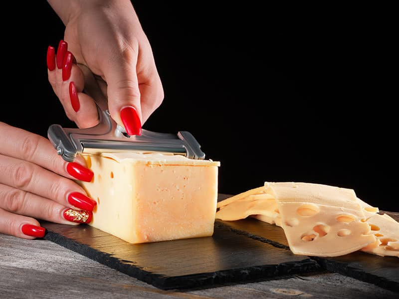 Woman Uses the Cheese Slicer
