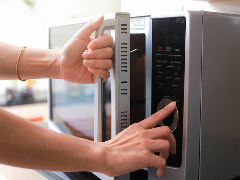 Closing Microwave Oven Door