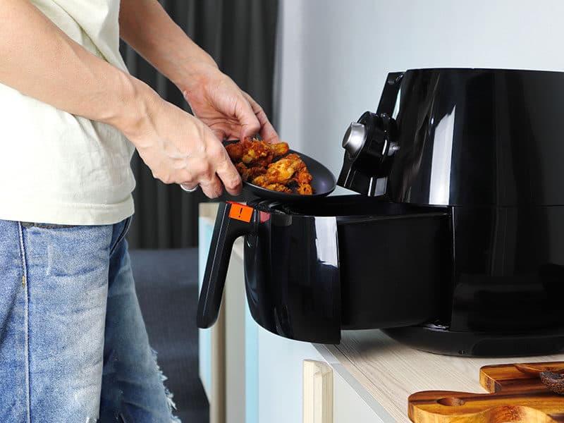 Hand Putting Fried Chicken