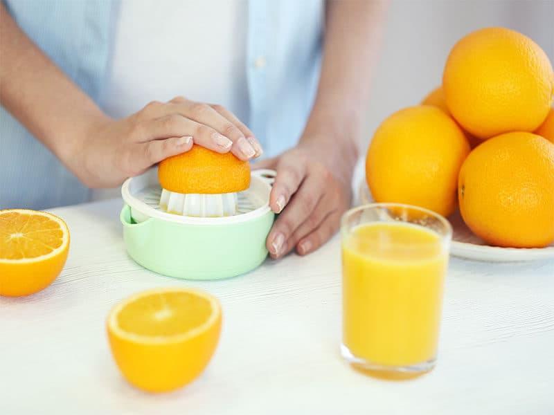 Hands Making Orange Juice