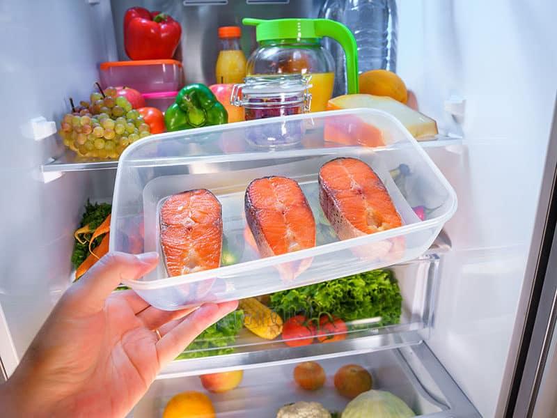 Raw Salmon Steak on Refrigerator
