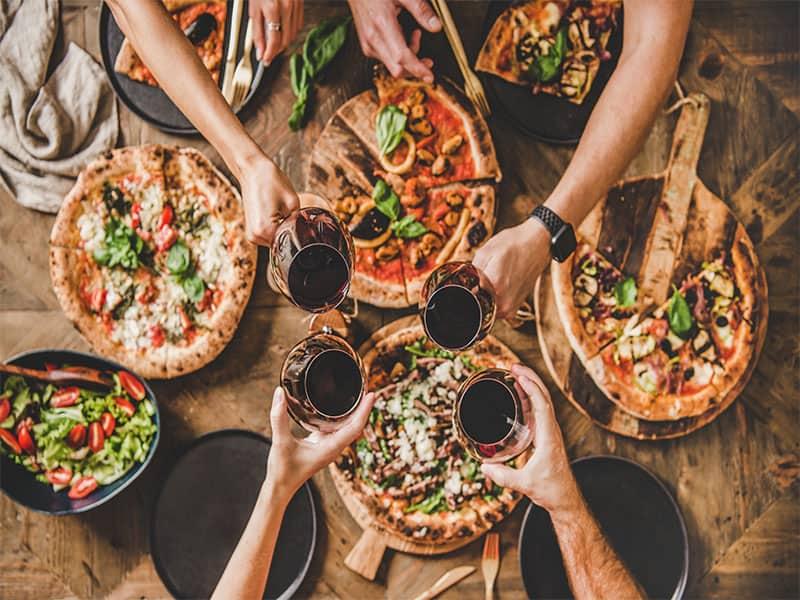 Family Friends Having Pizza