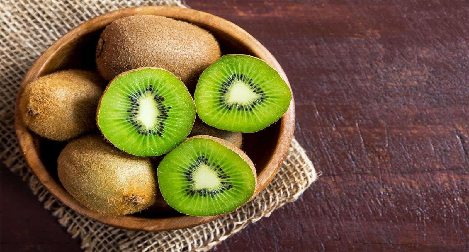 Kiwi Fruit On Wooden