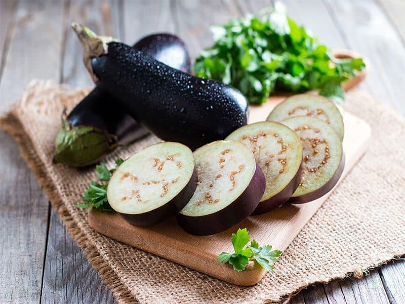 Sliced Eggplant On Wooden